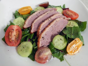 Smoked Duck Breast over Dandelion Greens